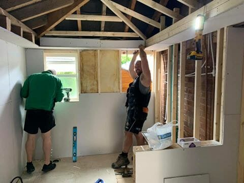 Tim Oakes and Ollie Brown busy building the wet room (1)